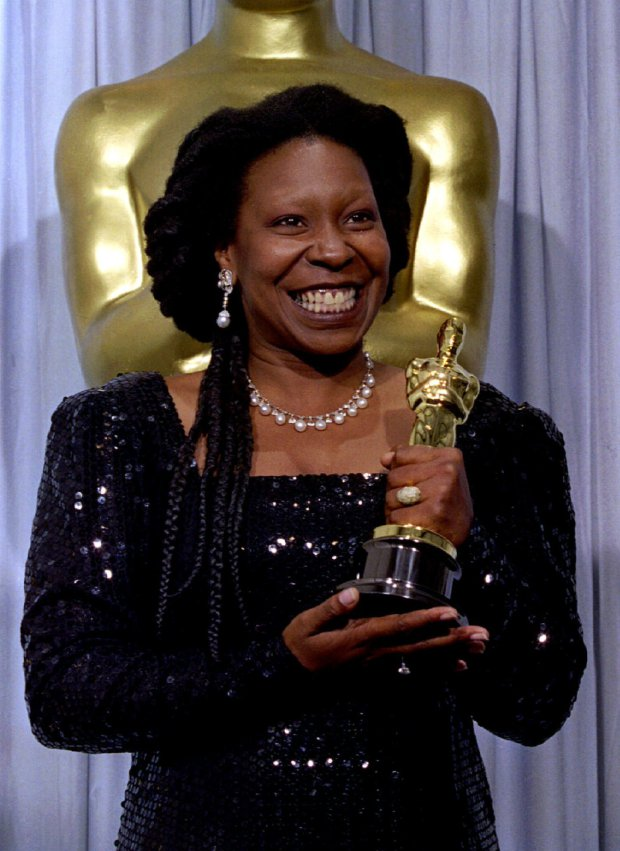 "Whoopi Goldberg is shown holding her Oscar after winning Best Supporting Actress for her role in ""Ghost"" at the 63rd Academy Awards March 25 1991 - RTXFGMT"